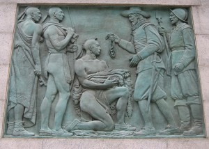 Explorer, Henry Hudson, steps ashore in Manhattan, in September, 1609, to trade with the Indians. Photo courtesy of Paul Romaine. From the Henry Hudson Memorial, Bronx, NY.
