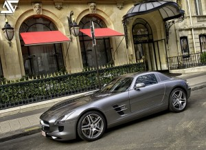 There's little relation between Lewis Hamilton's F1 Mercedes and cars you see in the Mercedes showroom. But this Mercedes SLS AMG is racy enough for most, wouldn't you say? This photo courtesy of  A.G. Photographe
